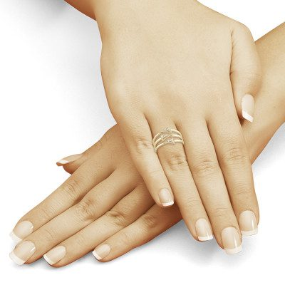 Beautiful manicured female hands on red background